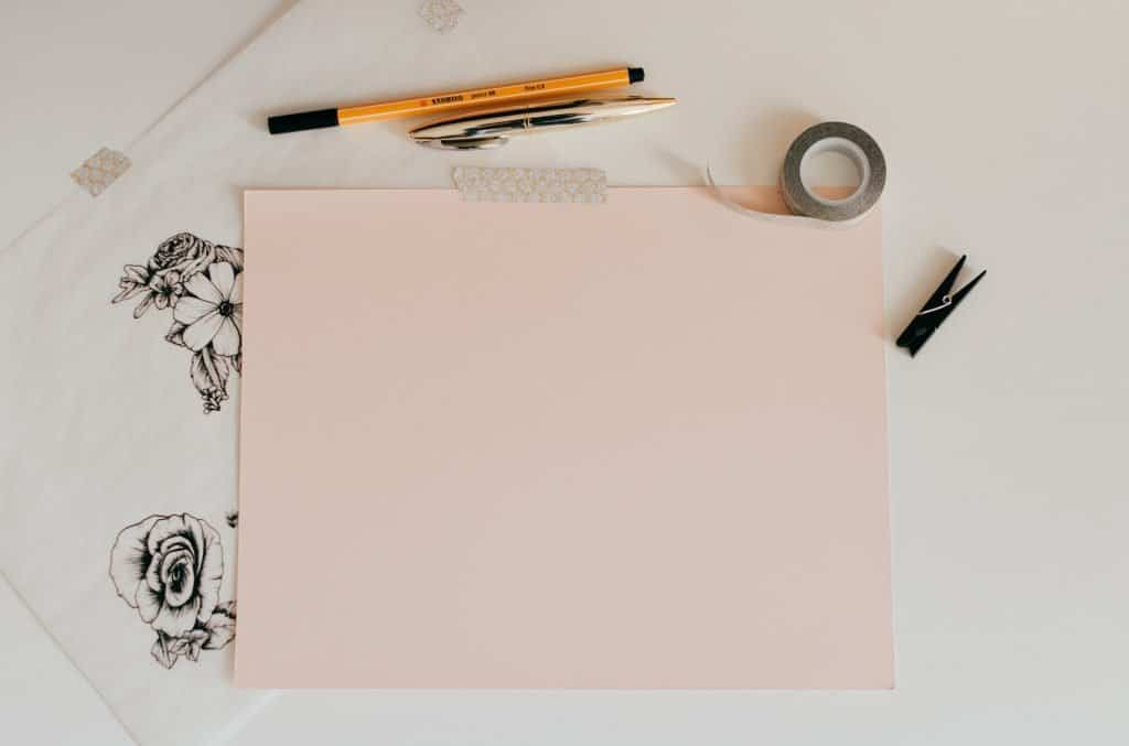 pink paper and other crafting supplies