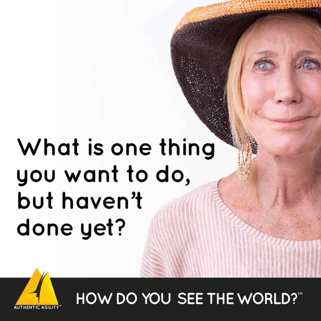 older woman with large display of question: What is one thing you want to do, but haven't done yet?
