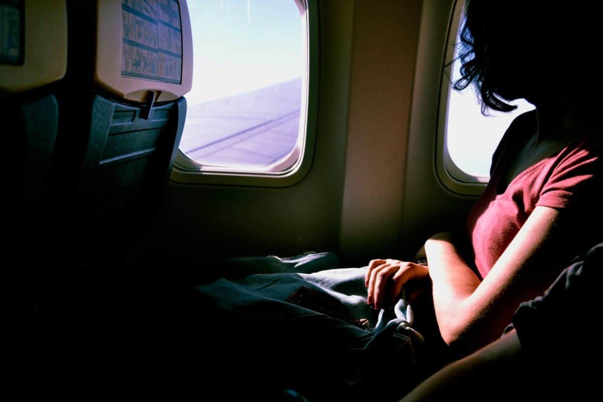 woman riding in airplane