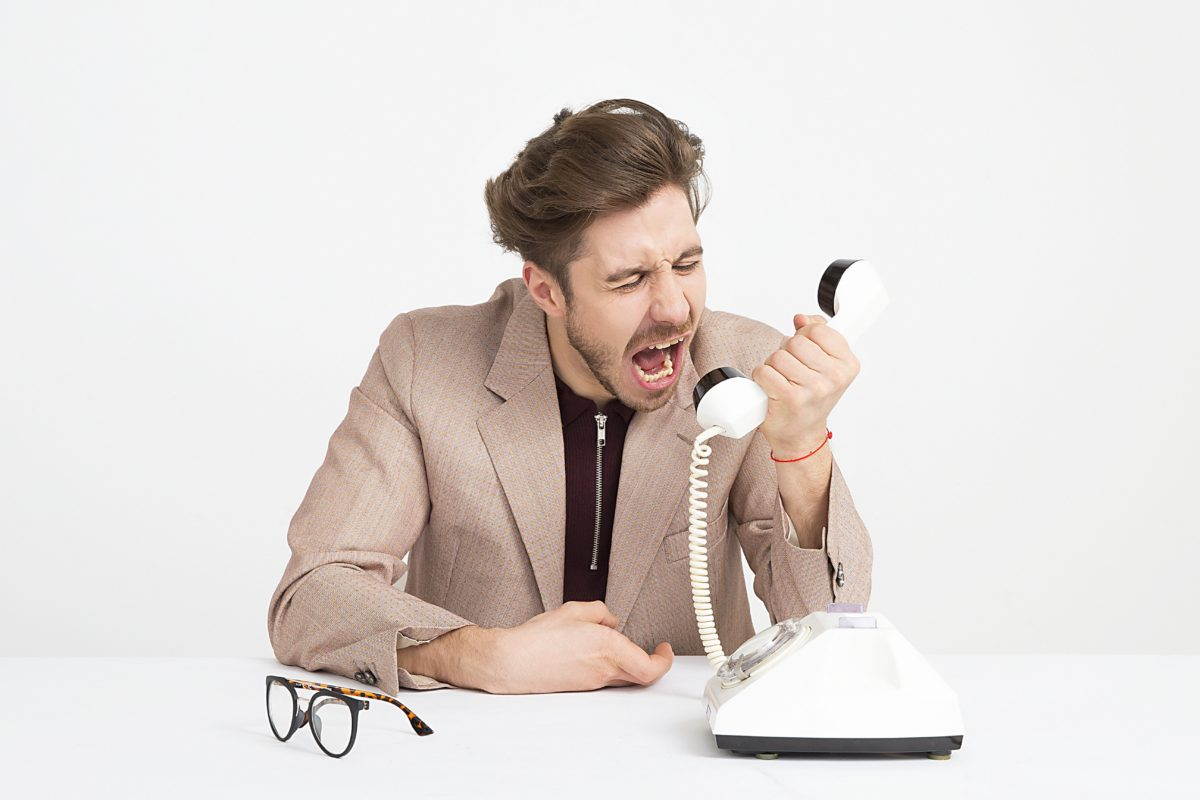 business man yelling into phone