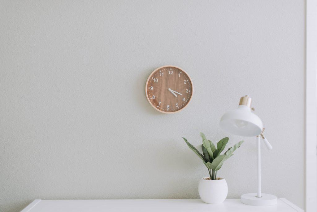 clock on white wall in white office